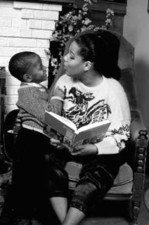 11 smiling black mother and son reading b&w