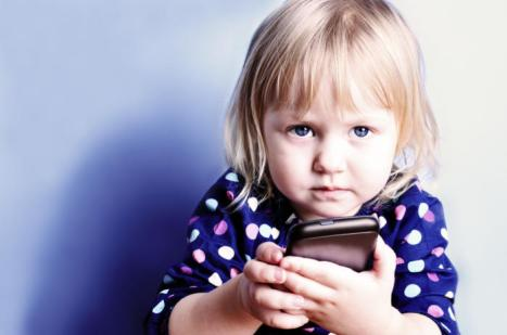 child_holding_cell_phone_thinkstockphotos-460194799-100584900-large
